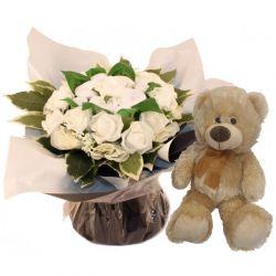 Bouquet de 8 layettes et son ourson Brun
